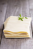 Lasagna sheets stacked on table Royalty Free Stock Photography