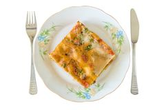 Lasagna slice in a plate isolated Stock Photo