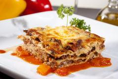 Lasagna on a square plate. Italian lasagna on a square plate Royalty Free Stock Image