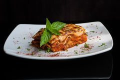 Lasagna on a square white plate Royalty Free Stock Photos