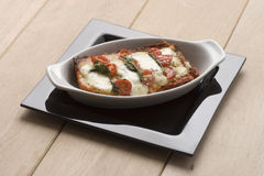 Lasagna with tomatoes Stock Photo
