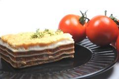 Lasagna and tomatoes Royalty Free Stock Images