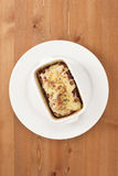 Lasagna. On a tray with bright lighting Royalty Free Stock Photography