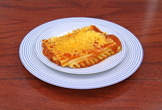 Lasagna on two blue plates Stock Photos