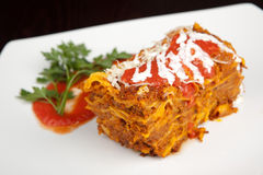 Lasagna on a white plate Stock Photos
