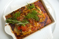 Lasagna in a white plate Royalty Free Stock Images