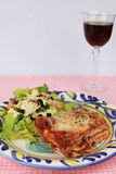Lasagna with Wine Stock Photography