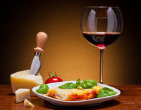Lasagna and wine Royalty Free Stock Photos