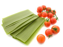Lasagne. Sheets with  tomatoes on a white background Stock Image