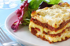 Lasagne. Beef lasagne with salad.  Melting mozzarella and ricotta cheeses - delicious Stock Image