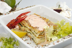 Lasagne. Arranged with lettuce and lemon Stock Image