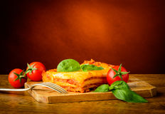 Lasagne with basil and tomatoes Stock Photos
