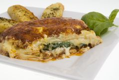 Lasagne and garlic bread Stock Images