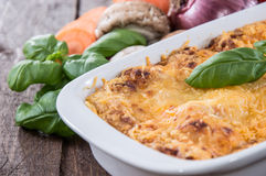 Lasagne in a gratin dish Stock Photos