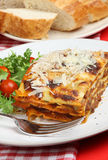 Lasagne Meal. Beef lasagna with salad and crusty bread Royalty Free Stock Photography