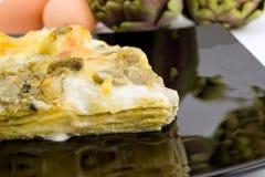 Lasagne mit Artischocken Stockbild
