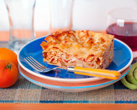 Lasagne plate on a tabletop. Fresh homemade Lasagne layout on a plate Royalty Free Stock Photos