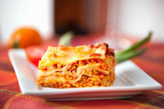 Lasagne plate on a tabletop. Fresh homemade Lasagne layout on a plate Stock Photo