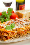 Lasagne with ragu. And red wine Royalty Free Stock Photos