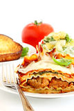 Lasagne with salad Royalty Free Stock Photos