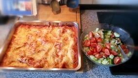 lasagne and salat Stock Photos