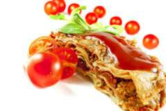Lasagne. With tomato and vegetables on white background royalty free stock images