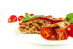 Lasagne. With tomato and vegetables on white background stock photos