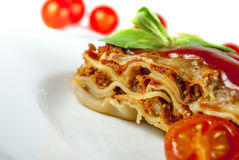 Lasagne. With tomato and vegetables on white background stock image