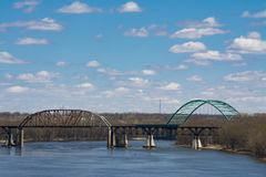 Overlooking the Illinois River. LaSalle Rail Bridge and Abraham Lincoln Memorial Bridge on the Illinois River on a Spring afternoon. LaSalle, Illinois, USA royalty free stock image