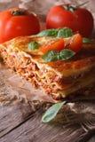 Lasanhas com manjericão e tomates em uma tabela velha, rústico vertical fotos de stock royalty free