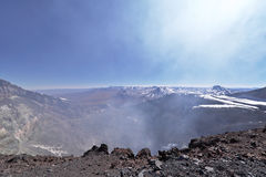 Lascar volcano crater with fumaroles. This volcano is located in the Atacama desert in Chile. The summit is at an altitude of 5600m Royalty Free Stock Photo