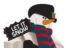Lasciate esso nevicare! Pupazzo di neve che tiene un segno. Fotografie Stock Libere da Diritti