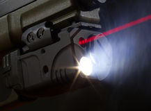 Laser aiming on a handgun Stock Photography