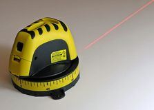 Laser Beam. Laser measuring tool emitting beam stock photo