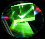 Laser beam shining through a prism. Laser beam passes through a glass prism stock image