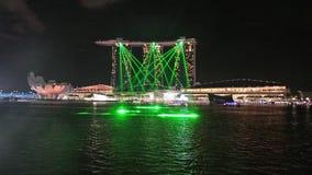Laser Beams  display infront of Marina Sand Bay Stock Image