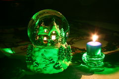 Laser Christmas crystal ball and candle Royalty Free Stock Images