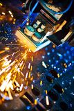 Laser close-up. With sparks Royalty Free Stock Photo