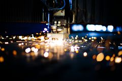Laser close-up. With sparks Royalty Free Stock Images