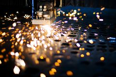 Laser close-up. With beautiful emitted sparks Stock Photography
