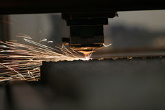 Laser close-up. Lasercutting close-up from metalwork industry Stock Image