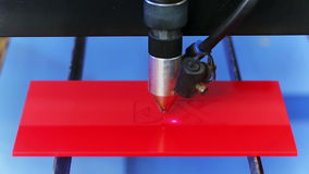 Laser cnc machine cutting red acryl plate Stock Photos