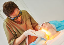 Laser cosmetology treatment Stock Photos