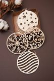 Laser cut Wooden Cristmas Decorations on Brown Baackground. Wooden Globes. Vertical Image. Laser cut Wooden Cristmas Decorations on Brown Royalty Free Stock Photo