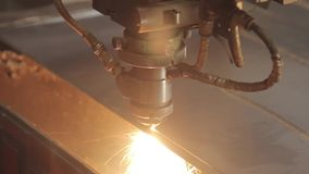 The laser cuts the metal. Industrial equipment for metal cutting. Machine with a laser. The machine with a laser cuts a thick metal sheet with bends stock footage