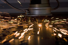 Laser cutting. Metal sheet in factory, with sparks flying around Royalty Free Stock Image