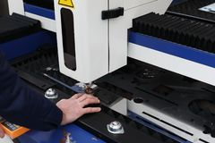 Laser cutting machine with CNC control in process. Selective focus royalty free stock photos