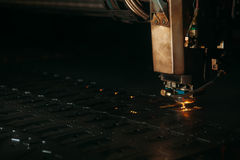 Laser cutting machine cuts the metal with sparks. Industry Stock Photos