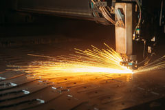 Laser cutting machine cuts the metal with sparks. Industry Royalty Free Stock Photos