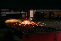 Laser cutting machine cuts the metal with sparks. Industry Stock Photo